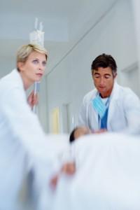 doctors rushing patient