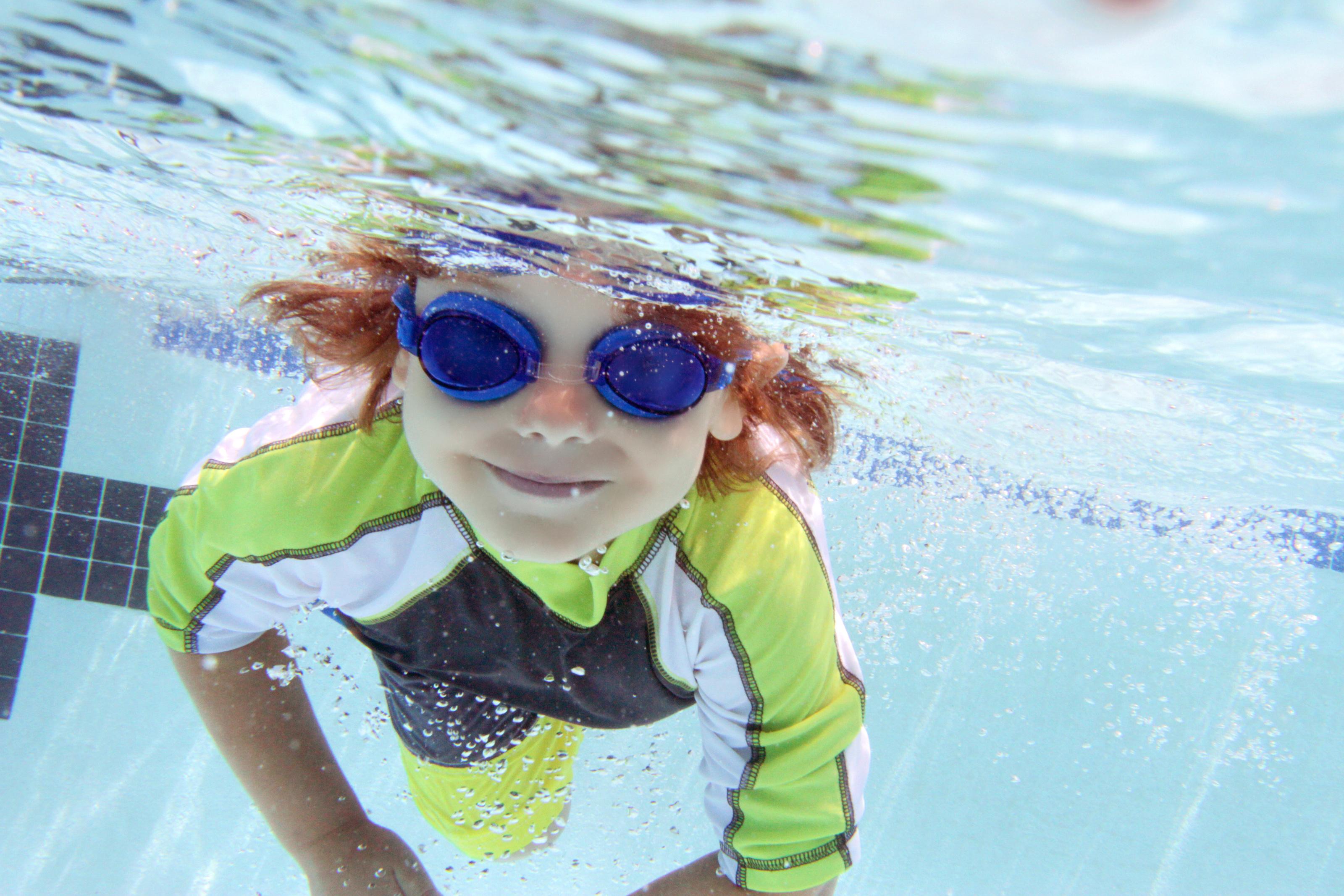 Child Swimming in Pool Underwater